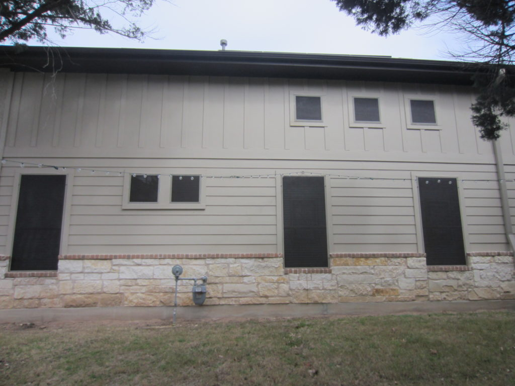 Right side of Austin TX Home: Showing (3) 2nd floor 90% Solar Screens & (4) 1st floor 80% Solar Screens