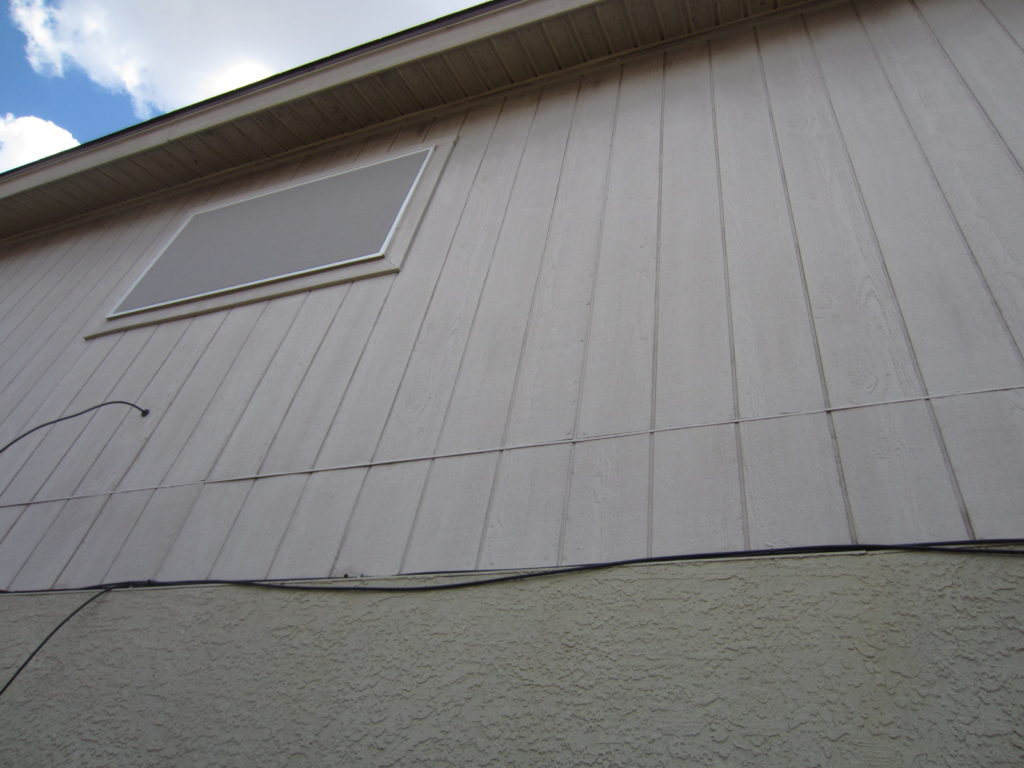 Gray solar screen for bathroom window.